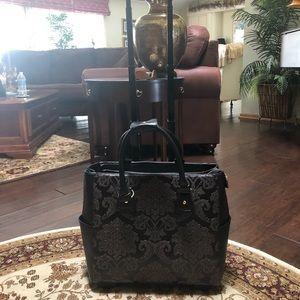 Wheeling leather brief case